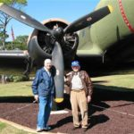 Bill Prindible with WWII C-47 Radio Operator Mike Ingrisano posing with their actual WWII C-47 aircraft Hurlburt Air Force Base Fort Walton Beach, Florida approximately 2005.