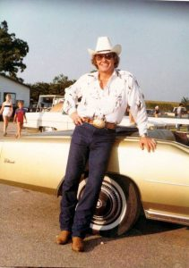 Jon Gilliam posing with his Cadillac.