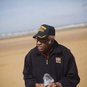 Ormand collecting sand on Omaha Beach during his June 2013 visit to Nromandy, France.
