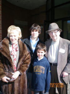 Red Coleman and his wife with their grandsons, Justin and Brendan, at St. Mark's Grandparents Day. November, 2008