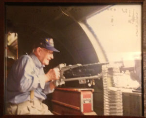Conrad Lohoefer in a B-17 plane in the position that he was in during World War II