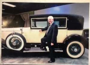 Bernie Dworkin with a car that he sold at auction.