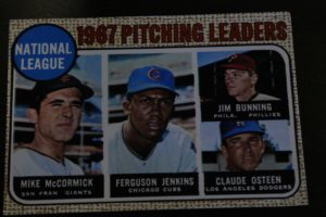 A 1967 baseball card featuring the best pitchers in the nation with Claude on it