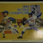 A baseball card for the 1965 world series winners including Claude