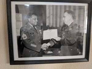 Dana Carroll receiving a certificate for the army commendation medal
