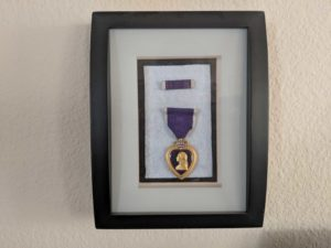 Dana Carroll's purple heart medal for being injured during the war