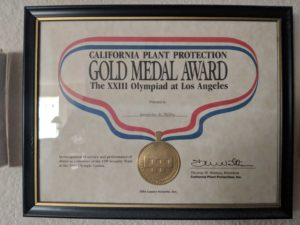 Gwen Carroll's Award she received for volunteering at the 1985 Olyimpics